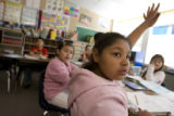 DM0648   Delilah Flores raises her hand in Ms. Deanna Blunt's second grade class at Valley View...