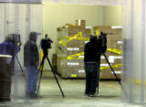 Television media get a look  at  Jefferson County  Schools storage warehouse,s recalled meat...