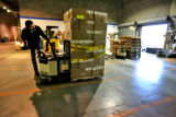 Jefferson County  Schools storage warehouse worker Doug Cone (cq) moves boxes each containing...