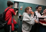 At the end of school, JV basketball player, Asher Kaye, (cq) gets items out of his locker as...