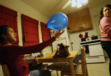 MJM155  15-year-old Melaina Marquez plays with a balloon while her mother, Michelle Benzor-Marquez...