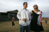 Annie Hellums (cq), right, looks at her husband-to-be Casey Duncan (cq), left, both of Denver,...