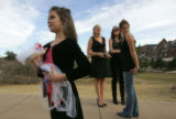 Lexi Hellums (cq), 8, left, holds the bouquet of her sister Annie Hellums (cq), center, who is...