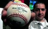 Jameson Sutton, 24, of Boulder, holds Barry Bond's 762nd home run, his final home run, hit at...