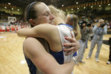 456 (5A) Highlands Ranch Falcons' #22, Melia Ryba, left, and #1 Alya, right, hug in celebration as...
