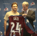 Colorado Avalanche Executive Vice President and General Manager Francois Giguere (right), gives...