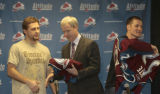 Colorado Avalanche Executive Vice President and General Manager Francois Giguere (center), gives...