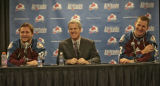 Colorado Avalanche Executive Vice President and General Manager Francois Giguere (center), with...