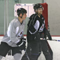 Newly acquired defenseman, Adam Foote, left, and Ruslan Salei, at Avs practice, Friday morning...