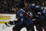[ JOE844 ] Colorado Avalanche Peter Forsberg, left, and Adam Foote move in on a face-off against...