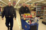 December 16,2004-Denver,Co.-Denver police Officers  Mike O'Donnell and Bill Csikos (cq) push a...