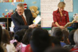 Gov. Bill Ritter and First Lady Jeannie Ritter read to a kindergarden, 2nd and 3rd class students ...