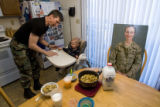 "DM0271   Master Sgt. Jeff ""J.T."" Theiral makes dinner for his two-year-old son Jarret as..."