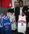 Art Bowser, assistant store manager of Mitchell & Ness, a retro sporting wear store in...