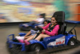 Vianney Sandoval, 14 (cq) and Stephanie Velazquez, 11,(cq) drive electric go-karts at Amazing...