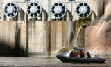 A boat floats next to the jet tubes at the Glen Canyon Dam in Arizona, on Tuesday, March 4, 2008. ...