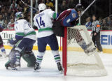 Wojtek Wolski gets driven into the net by #14 Alex Burrows the 3rd againstVancouver Canucks, March...