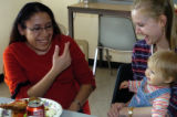 (DENVER Colo., December 16, 2004)  Fatima Uribe (left) enjoys the company of her teacher and case...