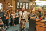 Cowboy Wes  (Rep. Wes McKinley (cq) D-Walsh),center,  is recognized in the House of...