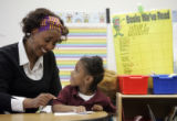 Linda Alston, a national-award winning teacher who works in low-income schools, reads with her...