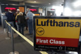 Travelers get ready  on Concourse A at DIA for a Lufthansa flight to Germany Thursday March...