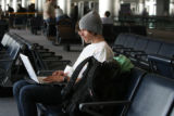Robert Sandgren (cq)  waits at Concourse A at DIA for a Lufthansa flight to Germany Thursday March...