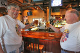 L to R: Tim Hartman (cq) and friend Rich Uhrich (cq) toast the beginning of the NCAA Basketball...
