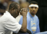 (Denver, CO  on 12/29/2004 ) - New Denver Nuggets coach Michael Cooper rubs his forehead during...