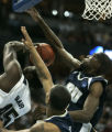 104 Pittsburgs' 45 DeJuan Blair, left, gets fouled by Oral Roberts' #33 Shawn King in the first...