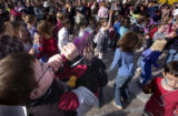 (Denver, Colo., December 31, 2004) Sierra Martin, 8, blows his horn to ring in the...