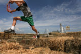 MJM193  Charlie Lundin (cq), 8, jumps hay bales at Centennial Livestock Auction as he attends a...