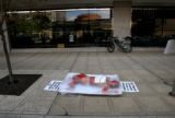 (PG0161) PETA intern Cassandra Callaghan poses as a corpse during a pro-vegetarian demonstration...