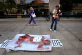 (PG0187) Lexus Tapia, 16, gets a closer look at a PETA pro-vegetarian demonstration outside of the...
