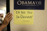 Eric Boyer, 88, leans against the doorway at the entrance of the new Obama campaign headquarters...