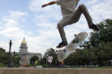DM0294  Garrett Langelaar of Parker, Colo. ollies over a set of stairs in Civic Center Park in...