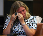 POOL PHOTO: Amber Rowell (cq) , registrar at Swedish Medical Center, choked back tears as she...