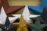 A detail of Amish Stars made from old tin roofing materials by Amish in Lancaster, PA. sit outside...