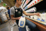 MJM123 Whole Foods Market employee, Sean Capek (cq) stocks milk Thursday 07/17/08 at the store's ...
