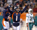 (Denver, Colorado, Dec. 12, 2004) Jason Elam celebrates his game winning field goal against the...
