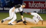 Jeff Dragicevich misses the tag on Mario Lisson (29) during the Tulsa Drillers vs. Northwest...