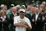 Eduardo Romero (cq) holds his trophy after winning the U.S. Senior Open Championship at The...