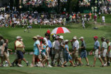 Fans cross a fairway during U.S. Senior Open Championship at The Broadmoor golf course 1 Lake...