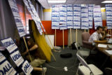 In between phone calls in support of Mark Udall's senate campaign, Henry Burton, 22, (cq) plugs...