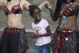 Khadijah Smith,(r)  and Sonia Burns show Zaria Johnson, 9 of Floriada some belly dancing movers at...