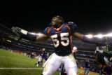 (DENVER, Co., SHOT 1/2/2005) The Denver Broncos' Patrick Chukwurah (#55, LB) dances in front of...
