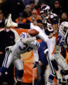 (DENVER, Co., SHOT 1/2/2005) The Denver Broncos' Ashley Lelie (#85, WR) tries unsuccessfully to...
