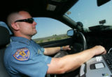 Trooper Pat Williams (cq), with the Colorado State Patrol, patrols on highway 76 near Brighton,...