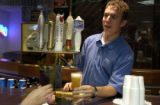 (GOLDEN, Co., May 24, 2004) Kevin Wurth, a student at Colorado School of Mines, serves samples of...