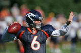 Jay Cutler throws a pass during a drill at Broncos training camp at Dove Valley in Cetennial,...