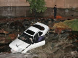 A car ended up in Cherry Creek at Speer Avenue and Corona Wednesday night after a two car...